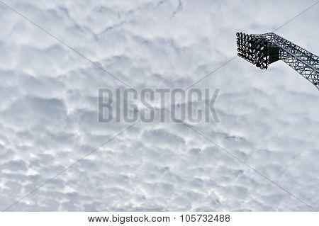 Stadium Spotlights With Overcast Sky