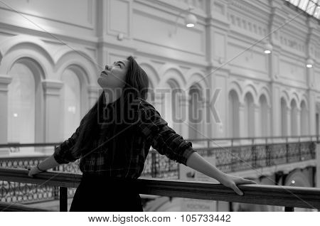 Girl Looking Up On The Balcony