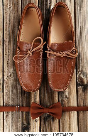 Fashion Brown Shoes With Bow Tie On A Brown Wooden Table