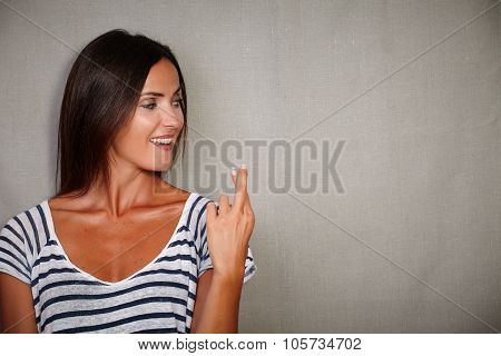 Confident Woman Crossing Fingers While Looking Away