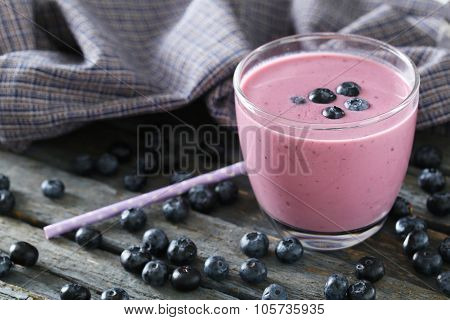 Fresh Blueberry Smoothie In The Glasses On Grey Wooden Background