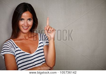 Confident Youngster Pointing Up While Smiling