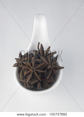 anise star in a white saucer