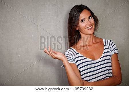Smiling Youngster Standing Against Grey Background