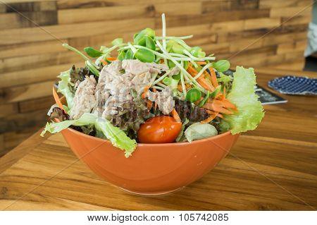 Tuna salad in orange dish