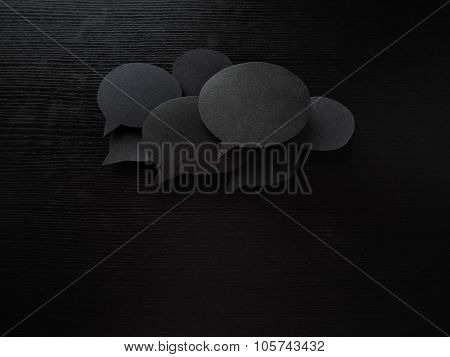 dark set  speech and thought blobs, lot of clouds for text made from Real materials, paper, wooden b
