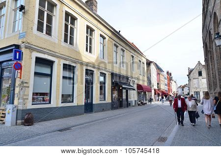 Bruges, Belgium - May 11, 2015: Tourist Walking On The Street In Bruges