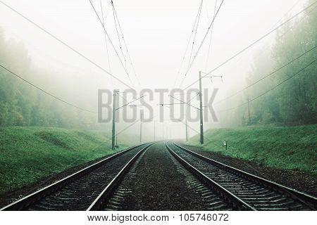 landscape with a railway in the fog