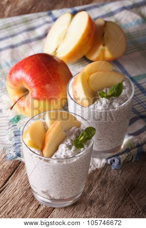 Chia Seed Pudding And Apples In A Glass Close-up On The Table. Vertical