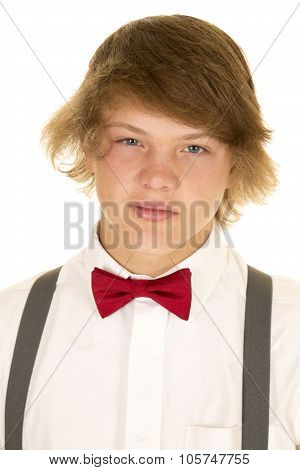 Portrait Of Boy With White Shirt And Bow Tie