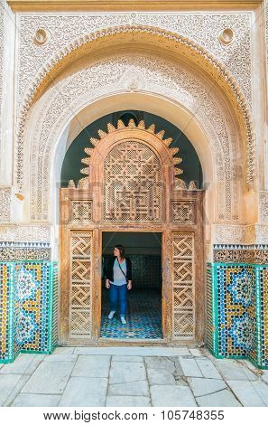 MARRAKESH, MOROCCO, APRIL 16, 2015: Tourists visit The Ben Youssef Madrasa