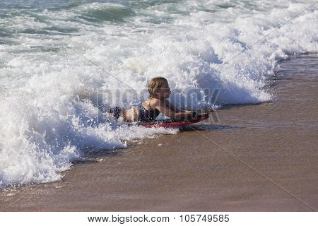 Girl Surfing Beach