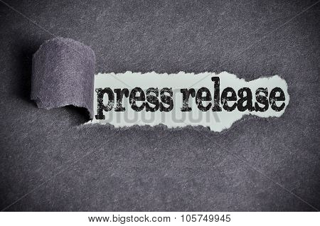Press Release Word Under Torn Black Sugar Paper