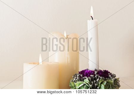 Three burned candels