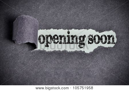 Opening Soon Word Under Torn Black Sugar Paper