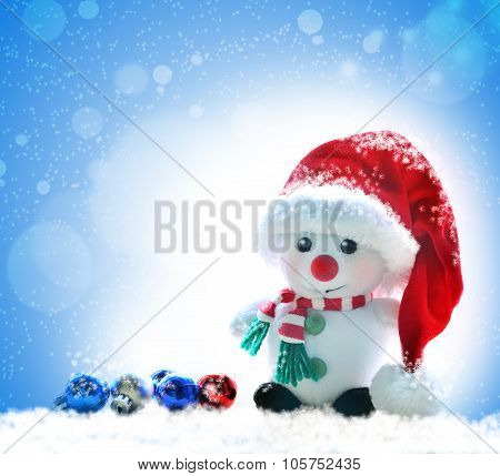 snowman in red hat on a snowy background
