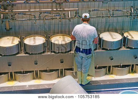 During Industrial Production Of A Famous Gruyere Cheese