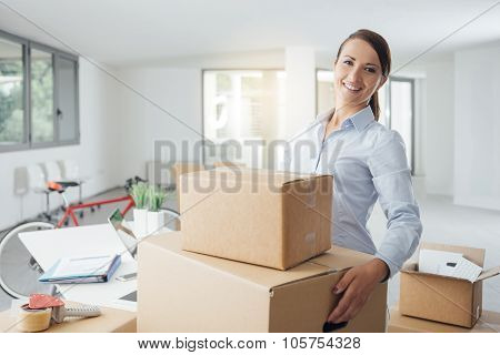 Happy Woman Carrying Boxes Into Her New Office
