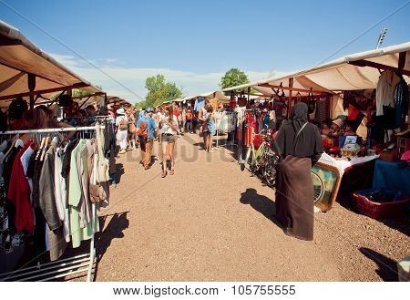 Muslim Woman Walking Through The Flea Market