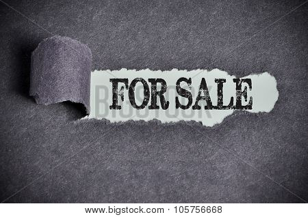 For Sale Word Under Torn Black Sugar Paper