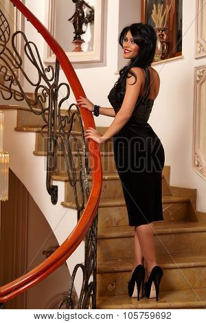 Beautiful Girl Smiling In An Elegant Black Dress