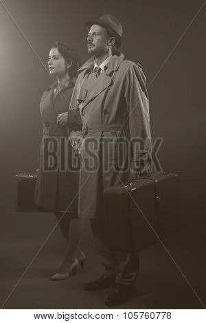 Film Noir: Elegant Couple Leaving In The Dark