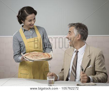 Smiling Wife Serving Dinner