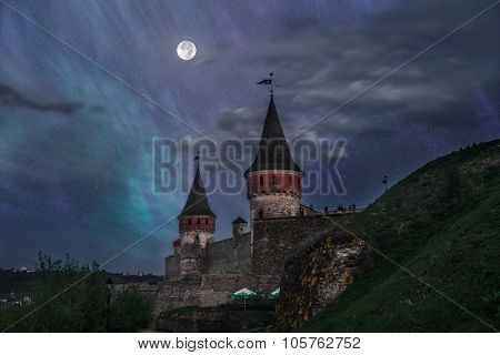 View on the castle in Kamianets-Podilskyi in the nigth Ukraine