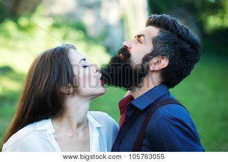 Woman Biting Male Beard