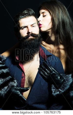 Man With Beard And Girl In Gloves