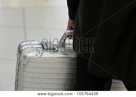 Man Carrying Metallic Security Suitcase