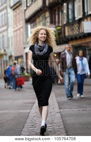 Blond Lady Walking Along Street