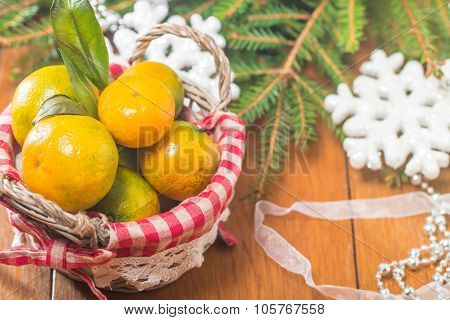 Tangerines In Plate And Branch Of Coniferous