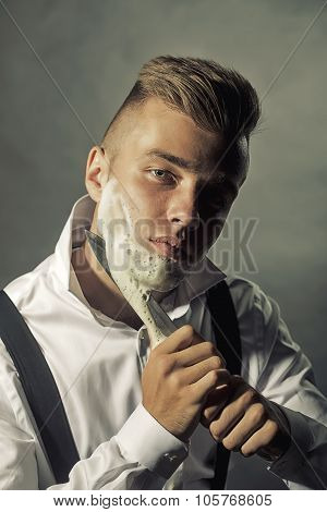 Young Man Shaving With Knife