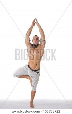 Male Acrobatic Dancer Balancing in Studio