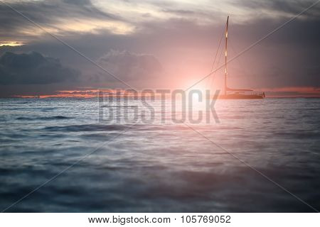 Yacht Floating In Sea Under Amazing Sunset