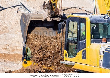 excavator on a construction site. excavator bucket with soil, earthworks.