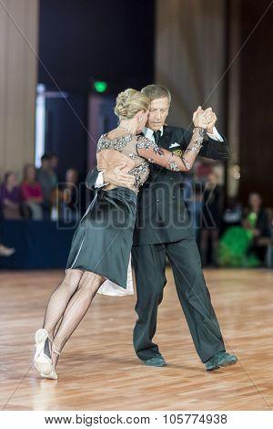 Minsk, Belarus - September 27, 2015: Professional Italian Couple Perform Pro-am Standard Program Dan