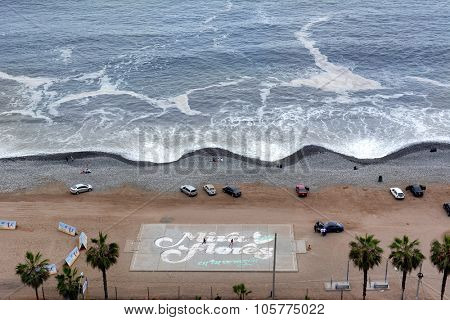 LIMA, PERU - OCTOBER 18, 2015; Mira Flores Beach. Beachgoers and cars on the beach in Lima's trendy Mira Flores District.