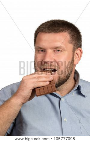 Man with beard eating chocolate