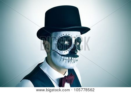 portrait of a young man with mexican calaveras makeup, wearing bow tie and top hat, with a slight vignette added