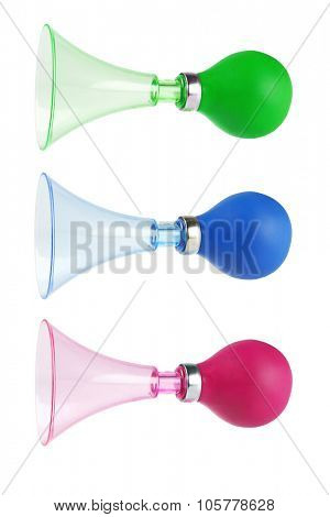 Plastic Toy Horns on White Background