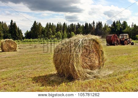 Making Big Round Bales Of Hay For Cattle Feed