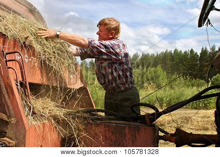 Harvesting Hay Baler, Russian Farmer Tractor-driver Repair Used Agricultural Machinery.