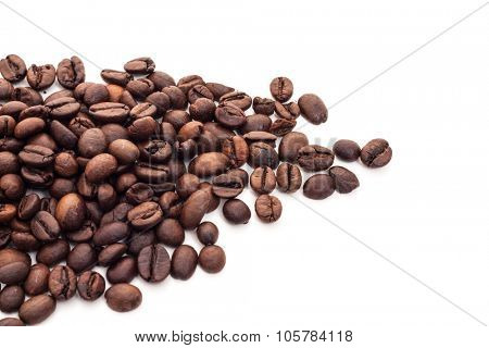 Fine roasted coffee beans on white background
