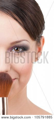 Beautiful woman with cosmetic brush for powder, isolated on white