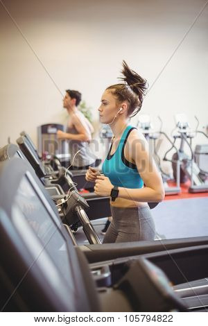 Fit woman using the treadmill at the gym
