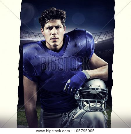 Close-up portrait of serious sportsman holding helmet against american football arena