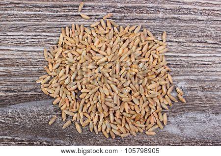 Heap Of Rye Grain On Wooden Background