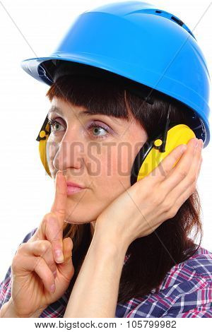 Woman Wearing Protective Helmet And Headphones, Silence Sign